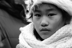 Little girl (d_t_vos) Tags: street winter portrait blackandwhite bw white black haarlem netherlands girl face hat contrast scarf asian outside nose eyes child coat watching streetphotography lips littlegirl shawl grotemarkt watchingme woolenhat woolenshawl whiteshawl facesofportraits dickvos dtvos