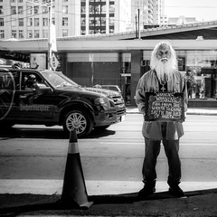 messenger. (jonathancastellino) Tags: street toronto man sign truck beard message religion stranger figure intersection yonge dundas jagermeister jager