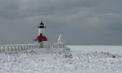 An icy day (tquist24) Tags: winter lighthouse lake cold ice clouds canon geotagged michigan lakemichigan tiscorniapark stjosephlighthouse canonpowershotsx10is