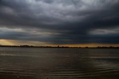 Una citt schiacciata dalle nuvole (Antonio Crisponi) Tags: cloud man colors photo nuvole foto expo una fisher non inverno spiaggia cagliari dalle citt poetto 2015 ufficiale schiacciata horizzontal