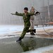 Canadian and American soldiers train in freezing water in Latvia
