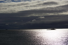 Below the eclipse. (artanglerPD) Tags: sea sky clouds dark shiny under atmospheric suneclipse
