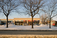 North American Strip Mall (caribb) Tags: street winter urban canada montral quebec montreal budget qubec shops daycare stores stripmall avis garderie 2015
