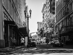 Street Shade (TMimages PDX) Tags: iphoneography photography image photo photograph streetscene fineartphotography geotagged people urban city street streetphotography portland pacificnorthwest sidewalk pedestrians buildings avenue road blackandwhite monochrome vignette