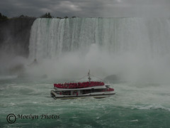 In the Midst (moelynphotos) Tags: niagarafalls maidofthemist waterfalls powerful majestic touristattraction worldfamous iconic boat touristboat tourists vacationdestination rushing water niagarariver choppy newyork canada ontario outdoors landscapeformat river moelynphotos