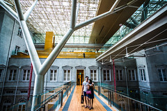 On the bridge under the tree (Phg Voyager) Tags: bridge indoor outdoor singapore nationalgallery trendy couple color phgvoyager boy girl building modern museum gallery visiting structure leica m9 18mm cityhall supremecourt asia
