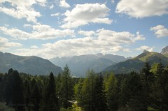 From a distance (Vee living life to the full) Tags: italy leger travel touring holiday landscape rock pass pordoi sella mountain people nikond300 heathaze valley floor motorcycle view car park road sky cloud blue