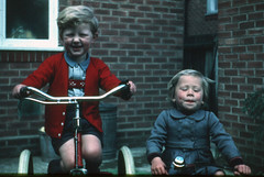 Makes you want to spit (theirhistory) Tags: boy child kid children coat trike tricycle jumper dungarees