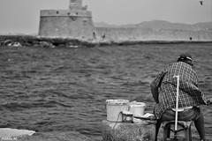 Man fishing - Khania - Crete (Nabila M.) Tags: bnw noiretblanc blackandwhite crete greece greek chania lacanee khania xania fisherman canoneos amateurphotographer sea port oldtown fishing island