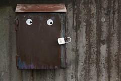 Mysterious box (blondinrikard) Tags: metal göteborg eyes rust shiny december box lock gothenburg rusty padlock combination concretewall 31december 2014 majorna secretcombination kombinationslås