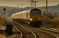GBRf Class 66/7 no 66713 negotiates the wobbly tracks into the old disused Edwinstowe Station with a discharged coal train from West Burton to Thoresby. (kevaruka) Tags: greatbritain sunset england sun color colour colors sunshine composition train canon warm flickr colours unitedkingdom shed rail railway sunny trains locomotive coal frontpage britishrail nottinghamshire sunnyday thoresby edwinstowe subsidence eastmidlands coalmining class66 canon100400l networkrail coaltrain gbrailfreight railfreight gbrf 66713 canon7d thoresbycolliery thephotographyblog thoresbypit ilobsterit edwinstowestation