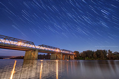 Train Of The Night || VICTORIA BRIDGE || PENRITH (rhyspope) Tags: new bridge blue trees mountains reflection water wales night train river dark lights star south trails australia victoria astro trail galaxy rowing aussie nepean weir
