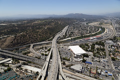 LA freeway and rail yard (US Department of State) Tags: ca la losangeles highway cities aerial transportation freeway roads westcoast