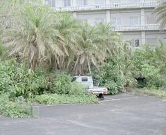 abandoned hotel (Egg Cheung) Tags: fujifilmgf670professional 6x7 fujicolorpro400h 120 film medium japan urbex haikyo decay wwwfacebookcomurbanfragment abandoned hotel hachijojima suzuki carry 4wd truck tree grass plant parking lot