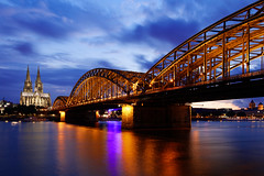 """""""Excuse me, sir. I see you've been standing here for a while. Are you waiting for something particular to happen?"""" - """"No."""" (Stopped.) Tags: bridge sky public water night clouds canon river lights lenstagged wasser cathedral dom cologne himmel wolken kln brcke fluss rhine rhein 70d canon18135f3556"""