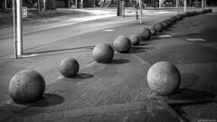 Amsterdam Spheres (Emil de Jong - Kijklens) Tags: nacht zwartwit blackandwhite amsterdam tropenmuseum knikkers bollen ballen night ball bal bol sidewalk outdoor diagonal diagonaal