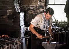 """It is better to be the hammer than the anvil""  Emily Dickinson (Explored) (lclower19) Tags: osv sturbridge massachusetts blacksmith anvil hammer forge odt metal m"