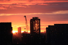 Sunset Fire (LakeRidge Photography) Tags: toronto crane tower skyline downtown clouds sky red orange shadow black glare sun
