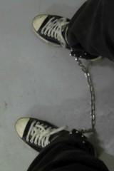 Converse in leg irons (asiancuffs) Tags: handcuffs handcuffed arrest arrested inmate prisoner shackles shackled