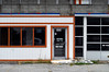 Indy#14963_Copy (Single-Tooth Productions) Tags: facade abandoned abandonedbuilding outofbusiness door glassdoor doorway entry entryway entrance garagedoor windows composition architecturalcomposition shapes lines colorblocks 2d flat architecture architecturaldetail architecturaldecay decay decaying neglect bleak forgotten e21stst indianapolis indiana urban city building buildingcomposition buildingdetail buildingdecay urbandecay 50mm nikkor nikkor50mm nikond200 nikon