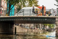 Amsterdam Trip-334-28.jpg (Sidekick Photo) Tags: floating leaves crossing people bridge canal amsterdam reflection water bikes bicycles trees