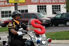 The S certainly isn't for smiles. (kennethkonica) Tags: red people usa male men yellow outdoors nikon midwest sitting indianapolis seat helmet indy police indiana nikond70s gloves harleydavidson pistol sit uniforms seating imp weapons hoosiers motorcyle whitegloves indianapolispolicedrillteam sidearmscops oosiers