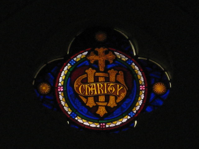 The Charity Lunette of the Stained Glass Chancel Window; St Judes Church of England - Corner of Lygon, Palmerston and Keppel Streets, Carlton