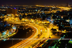 stock_DSC0610_Panoramic view of Vo Van Kiet highway, Ho Chi Minh city (or Saigon) by night, Vietnam (tranquocphongvn) Tags: bridge sunset sunlight nature skyline architecture skyscraper trafficlight twilight asia downtown cityscape exterior realestate horizon capital illuminated vietnam exotic pollution transportation eastern saigon hochiminhcity favela metropolitan apartmentbuilding prosperity indochina saigonriver officeblocks residentialbuilding famousplace streetroad villagehouses businesscentre touristdestination panoramicpanorama blueskyclouds bitexco landscapescene squattershacks skylinecity moderntower thuthiem marketurban travellocation commercialfinance constructionstructure tauhuchannel toproofs highlandmark financialeconomic slumurbanarea blackcanal slumshouses