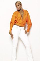 Mary J Blige wearing Lloyd Klein sunrise yellow silk top