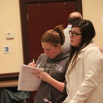 Students take notes during history capstone presentations.
