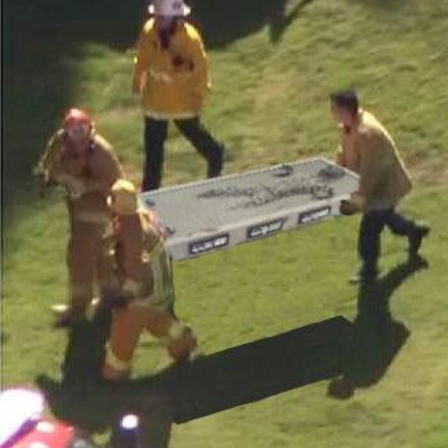 Here is a shot of the paramedics at the scene of the Harrison Ford plane crash site. Any word if Obama was on the golf course at the time?