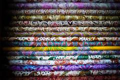 Silk (Leonid Yaitskiy) Tags: show india color colour demo nikon colorful dubai village market indian united stock uae silk stack shelf emirates arab souk 28 cloth nikkor cloths multicolored abu dhabi multi global leonid d610 iaitskyi