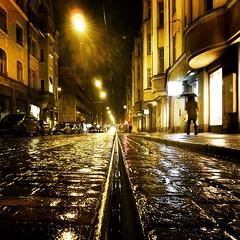 Helsinki | Rainy Tuesday (Toni Kaarttinen) Tags: morning shadow woman rain suomi finland walking square helsinki track finnland tram rainy squareformat helsingfors ludwig finlandia フィンランド finlande finlândia umbrell finnország finlanda finlàndia финляндия finnlando iphoneography instagramapp uploaded:by=instagram