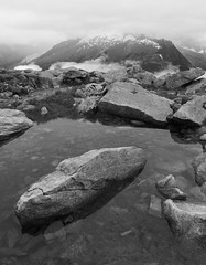 Aiguille Rouge (k335w) Tags: blackandwhite bw cloud brown mist mountain lake snow mountains alps green nature monochrome grass rock stone landscape lumix pond perspective wideangle panasonic aps mountian silkypix dmclx7 aiguillerougefrench