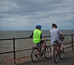 The bicycle ride, Crosby beach, Merseyside. (Barry Miller _ Bazz) Tags: bicycle beach seafront man woman canon5dmark2 sigma50mmf14 crosby merseyside cycle outdoor