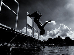 Backflip Off Of The Dock (Dan Constien) Tags: lake childhood backflip dock jumping fun water summer clouds