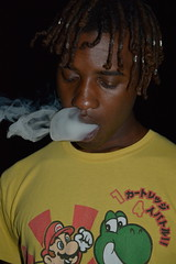 'The Night Show' (miranda.valenti12) Tags: the night shoot xzavier yellow smoking smokey smoke facial expression clouds cloudy cloud inhale exhale pothead weed dreads face closeup portrait darkness dark color colors outside outdoors outdoor