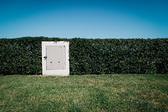 Untitled (glossormatt) Tags: hedge door sea sky spain green bands layers three