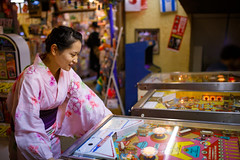 Young girl playing pinball at old Japanese shop (Apricot Cafe) Tags: japan katsushika katsushikafireworks shibamata sigma35mmf14dghsm tokyo colors festival fireworks night pinball standing summer traditionalclothes traditionalfestival woman yukata katsushikaku tkyto jp img645504