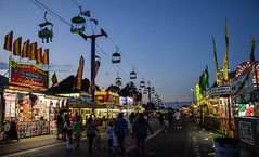 Night Falls (tim.perdue) Tags: ohio state fair 2016 summer exposition center columbus street candid colorful multicolored midway carnival night falls twilight blue hour evening skyride sky glider food tshirts crowd people