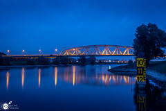 All in the blue (Robert Stienstra Photography) Tags: bridge bridges dutchbridges blue hour bluehour bluehourphotography riverscape dutchriver westervoort longexposure longexposurephotography landscape landscapes dutchlandscapes outdoor nikond7100 tamron18200mm nightscapes cityscape cityscapes reflection reflections