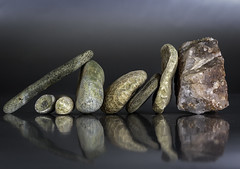 Different shapes in a row [Explored 2016-10-16] (kaffealskare) Tags: fotosndag fotosondag fs161016 rad row stones stenar struktur texture shapes former temafotografering themephotography reflections speglingar stilleben stilllife