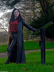 Woman with a Leather Coat - 3/6 (Mistress Maggie dot com) Tags: red woman black leather lady female fetish standing outdoors belt shiny pants boots coat longhair blouse jeans gloves mature trousers satin knee mistress blackhair domme leder belted
