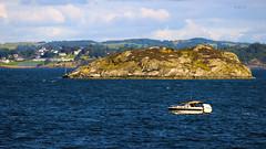 The Norwegian shores (P i j u s h) Tags: blue sea sky mountain nature water norway rock canon island boat north atlantic das pulpit 600d pijush
