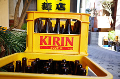 Kirin in yellow and red (Eric Flexyourhead (Trying to catch up!)) Tags: street city red urban detail beer yellow japan tokyo bottles vibrant empty vivid backstreet plastic drinks   kirin recycling empties beverages ricohgr crates containers fragment kagurazaka   shinjukuku