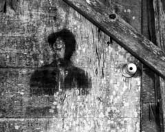 Portrait on an Alley Door (Baisao) Tags: nightphotography portrait bw slr film face mediumformat blackwhite noir 6x7 nightshooting nocturn neopanacros100 mamiyarz67proii ddx1411minpresoak hypoclear3min exchangeablebacks 65mmf4mamiyasekorzw