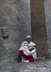 Bethe Medhaniale Church, Lalibela, Ethiopia (Eric Lafforgue) Tags: africa portrait people white men history church rock vertical wall facade religious outdoors photography clothing still day adult african faith religion headscarf monk medieval christian unescoworldheritagesite unesco celebration journey age devotion priest christianity shawl spirituality turban ethiopia orthodox pilgrimage oneperson developingcountry worldheritage traditionalculture lalibela orthodoxy hornofafrica ethiopian eastafrica orthodoxchurch traditionalclothing realpeople traveldestinations famousplace lookingatcamera cavechurch amhara onlymen buildingexterior fulllenght colorpicture onemanonly timket onematuremanonly timkat africanethnicity africanculture serenepeople monolithicchurch builtstructure copticchristianity colourpicture timqat ethio1411155