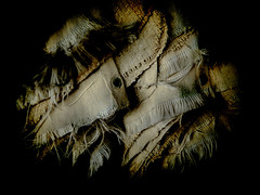 Sackcloth (Steve Taylor (Photography)) Tags: brown black art texture contrast digital cloth sack stark vignette eyelet frayed
