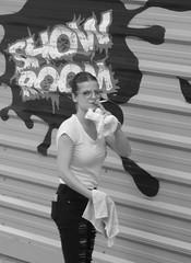Caught in the act.... (robbie20161) Tags: streetlife bw girl smoking cleaning showroom oldtown benidorm spain