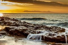 Sunrise in North Aegean, Greece (kyrsos1) Tags: greece northaegean beach calm europe mediterranean morning peaceful rock sea seascape seashore seaside shore sun sunrise travel vacation water wave